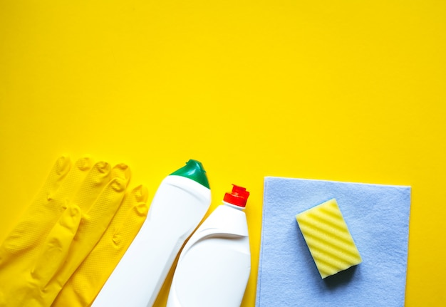 Cleaning supplies on yellow table