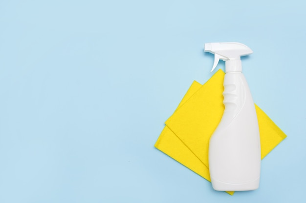 Cleaning tools. empty place for text or logo on blue background