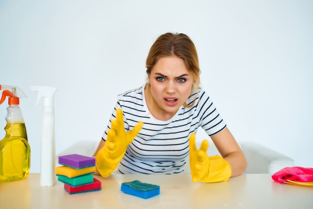 Cleaning woman detergent rags sponges protective gloves