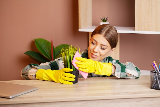 Cleaning worker cares for a plant