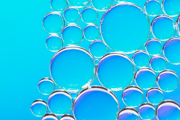 Clear air bubbles on azure background