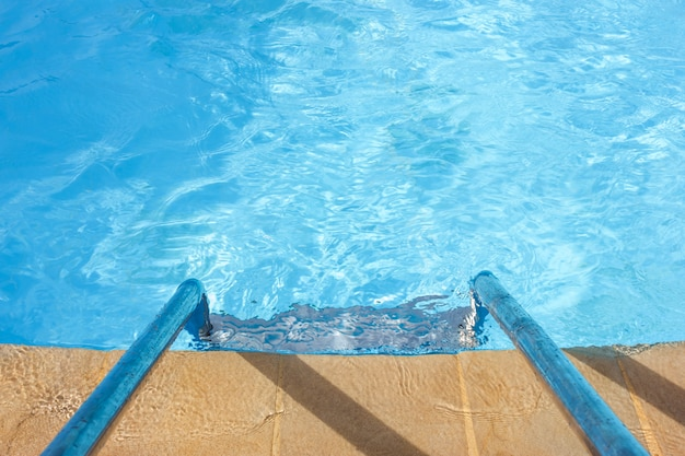 Clear blue water and a ladder in the pool