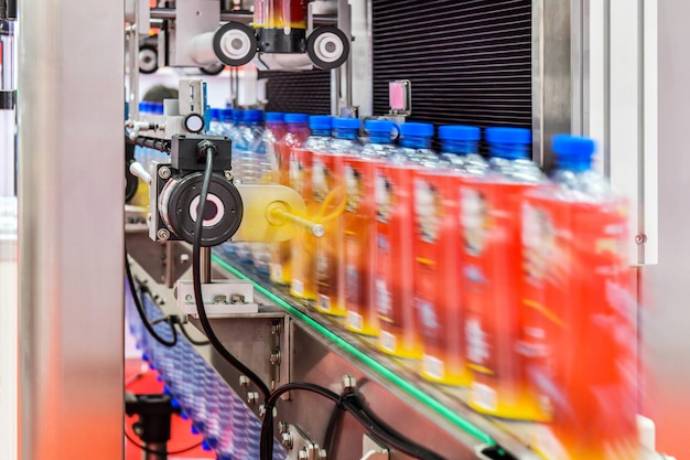 Clear bottles transfer on automated conveyor systems industrial automation for package