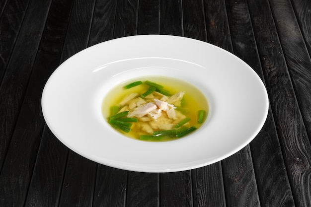 Clear broth with chicken and green beans