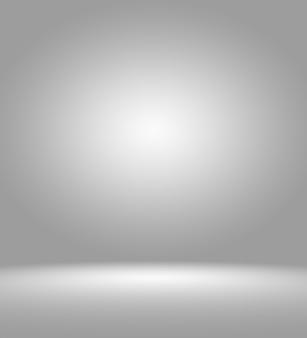 Очистить пустой фон студии фотографа аннотация, фоновой текстуры красоты темного и светло-синего, холодного серого, снежно-белого градиента плоской стены и пола в зимнем интерьере пустой просторной комнаты.