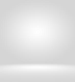 비어 있는 사진사 스튜디오 배경 추상화, 배경 질감은 아름답고 어둡고 밝은 파란색, 차가운 회색, 눈 덮인 흰색 그라데이션 플랫 벽 및 바닥이 비어 있는 넓은 실내 겨울 인테리어입니다.