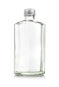 Clear glass whiskey bottle isolated