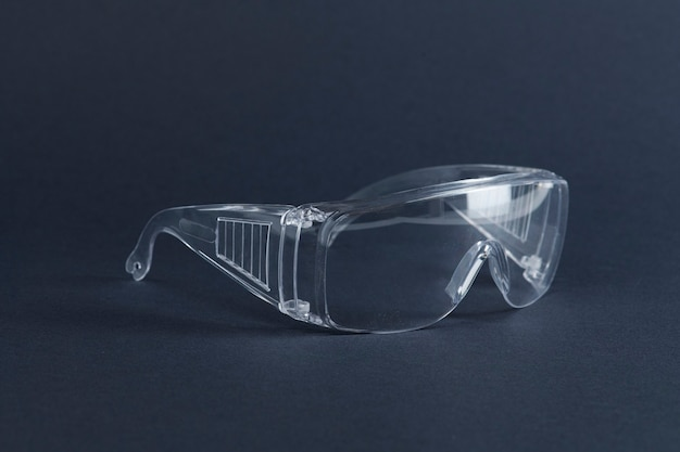 Clear goggles on a dark blue surface