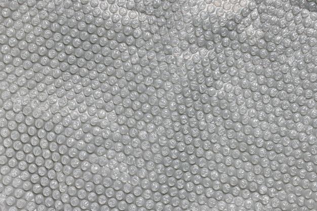 クローズアップテクスチャ背景汚染の概念を包むための透明な灰色のバブルフォイル