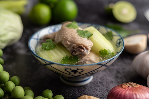 Clear soup with chicken with green hatch with garlic, lemon, onion, red onion, mushroom and basil