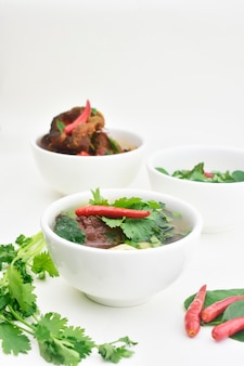 Clear soup with pork blood and meatballs thai food