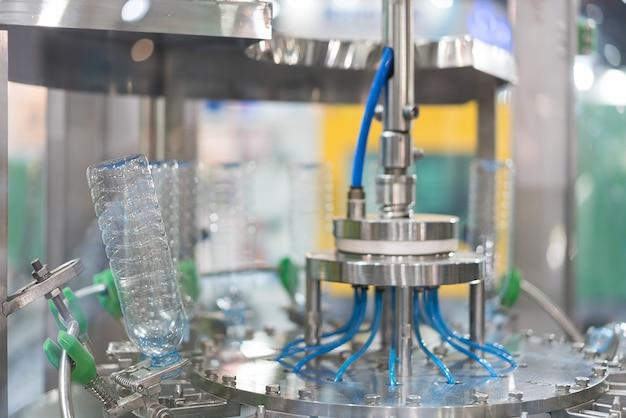 Clear water bottles transfer on conveyor belt system.