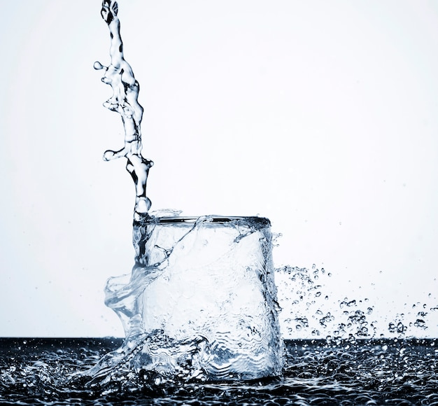 Clear water motion in glass on light background