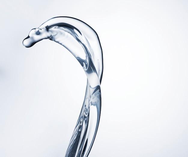 Chiara forma dell'acqua sul primo piano bianco del fondo cl