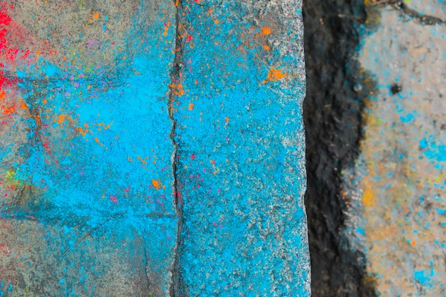 Cleft on paving stone in blue dye