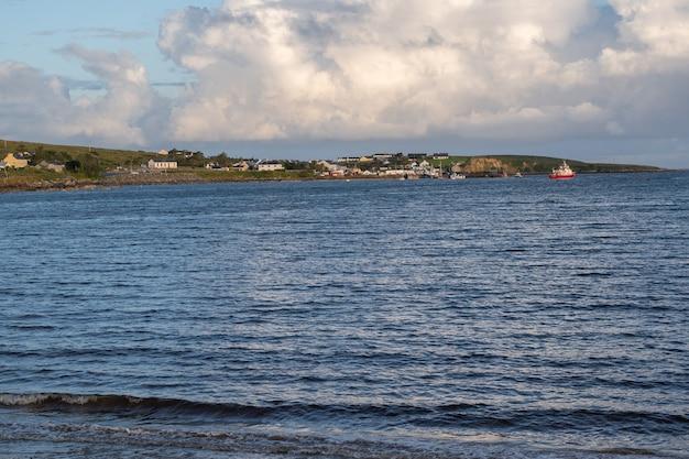 Cleggan village and fishing port from cleggan beach. connemara , galway , ireland