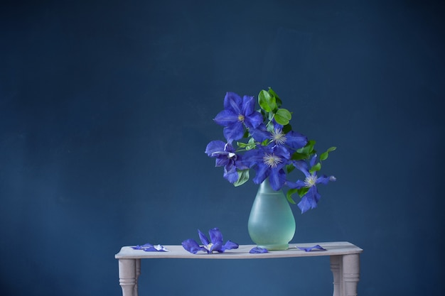Clematis flowers in glass vase
