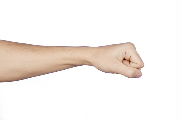 Clenched fist and arm of caucasian man, in the form of a blow, isolated on white background.