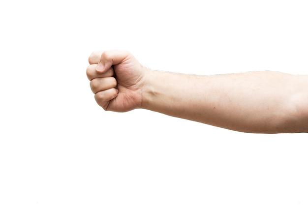 白い背景のくいしばられた握りこぶし。パワーコンセプト