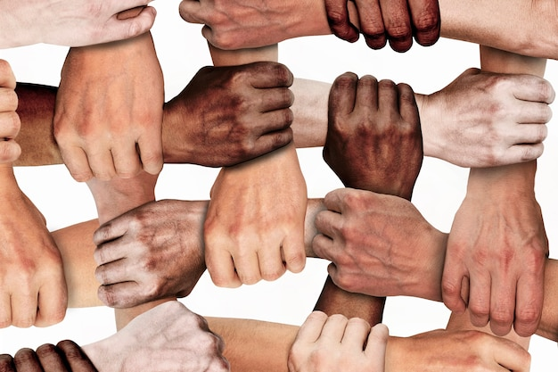 The clenched hands of working people of different nationalities with different skin colors. social protest against injustice and racism. black lives matter.