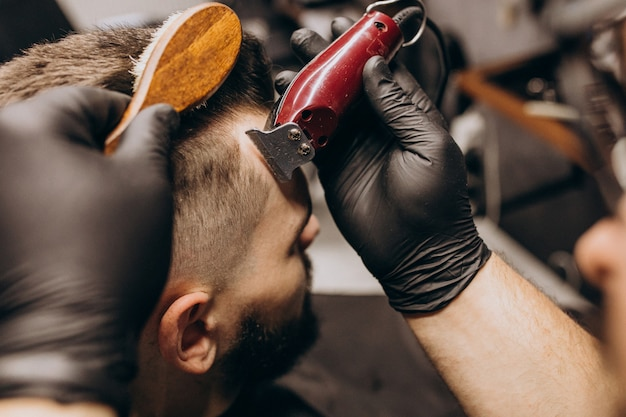 Client doing hair cut at a barber shop salon