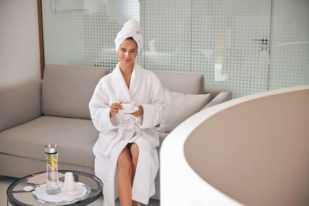 Client drinking tea in a luxury salon