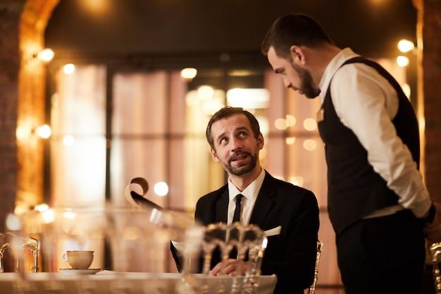 Client ordering food in restaurant