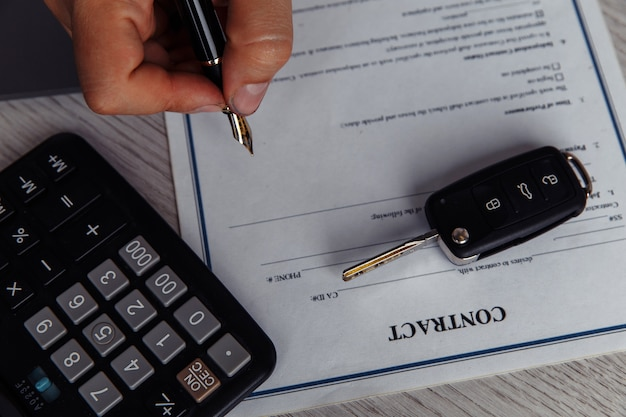 Client signing car lease form