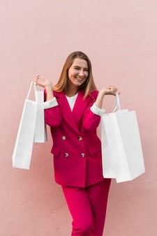 Client wearing fashion clothes and holding shopping bags
