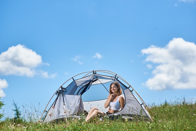 Climber sitting in tent