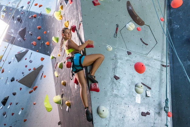 The climber trains on an artificial relief