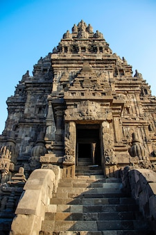 Climbing stairs to a prambanan temple. indonesia