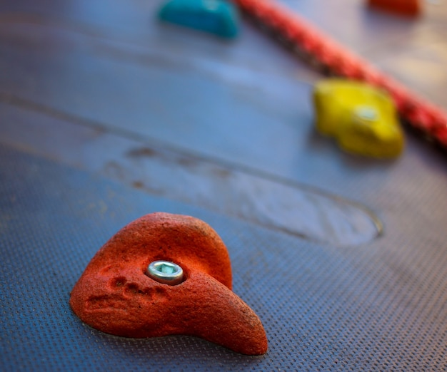 Climbing wall stone close up view. sport and active lifestyle equipment in a park.