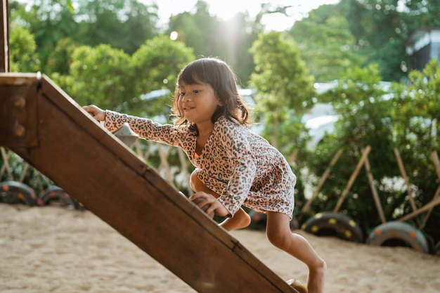 Climbing on a wooden board climb, a kind of facility to train a childs motorik