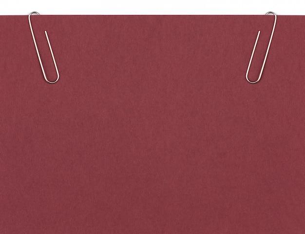 空白の紙のシートの背景を保持するクリップ