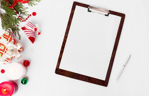Clipboard blank open christmas, fir branches pine cones candle flat lay copy space
