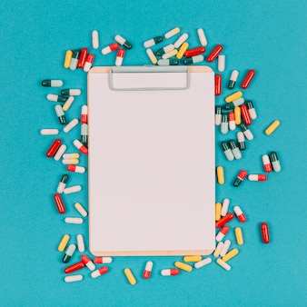 Clipboard and colorful pills