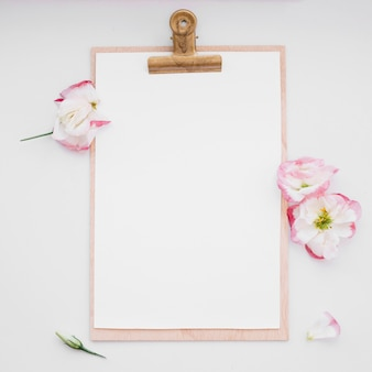 Clipboard and flowers