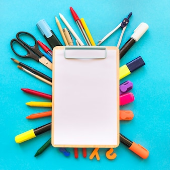 Clipboard lying on stationery