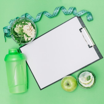 Clipboard lying with healthy food