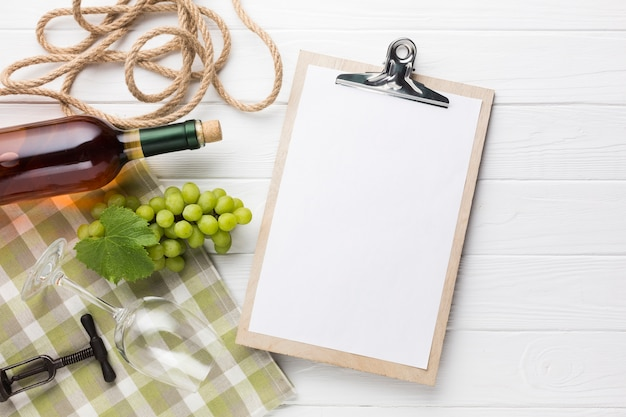 Clipboard mock-up with white wine