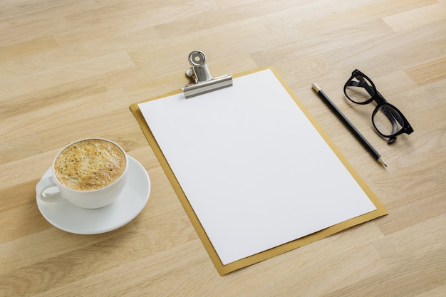 Clipboard mockup with coffee and glasses top view