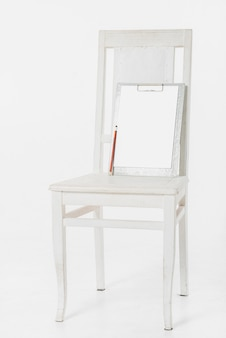Clipboard on wooden chair