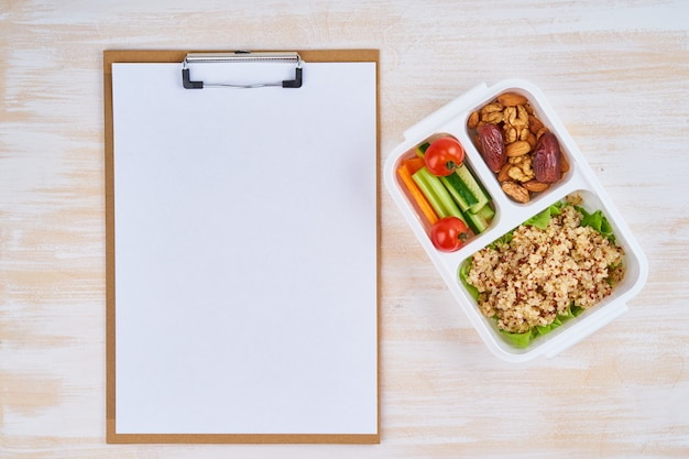 Clipboard, vegan lunch box, bottle. healthy vegetarian menu, weight loss, healthy lifestyle