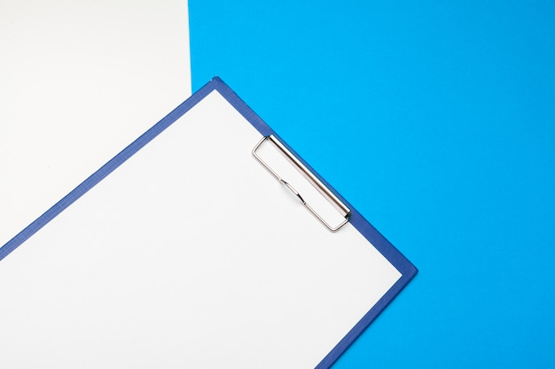 Clipboard  on vibrant duotone blue and white