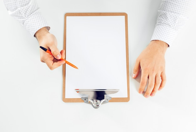 Clipboard on a white table. close up
