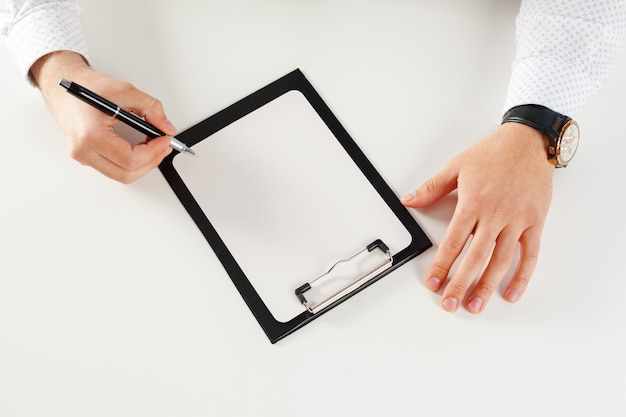 Clipboard on a white table