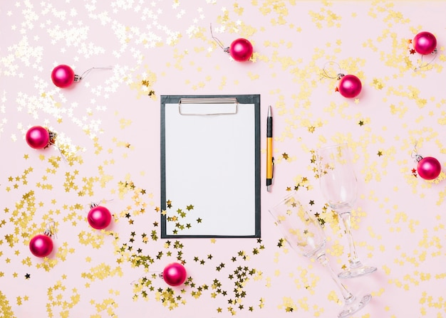 Clipboard with baubles on table