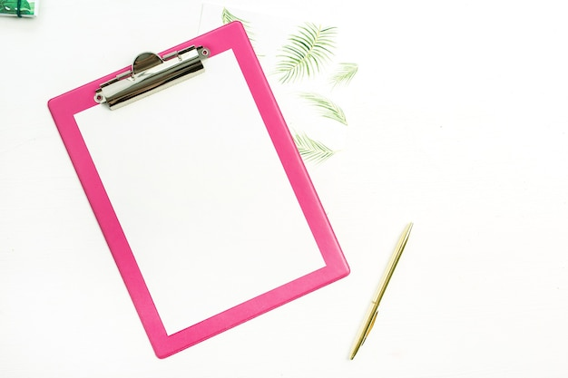 Clipboard with blank paper, notebook and pencil on white background. business mock up. flat lay, top view.