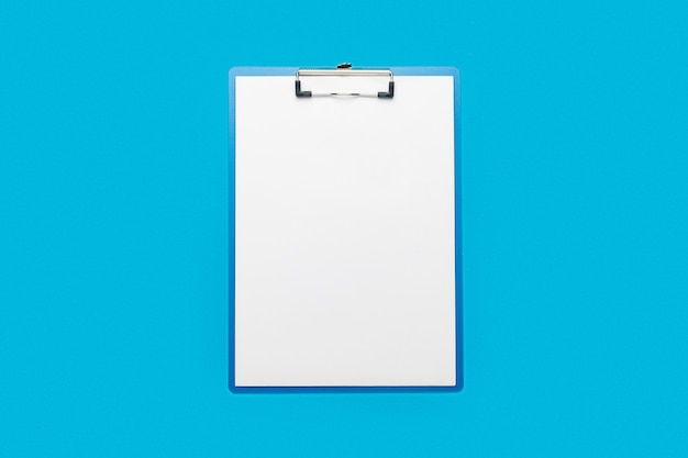 Clipboard with a blank sheet on a blue